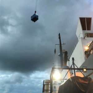 Launch Service to a cargo ship on Great Barrier Reef Queensland from port of cairns with company north marine delivers equipment and freight to passing ship