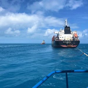 Tug Boat Assist Performing Towage Escort to Shipping Company from Torres Strait to Cairns Queensland Australia